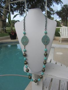 Faceted Large Turquoise With A Patina Filigree by JKCustomDesigns