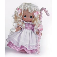 Searching for her lost sheep, the Precious Moments Little Bo Peep doll is downright charming in pink gingham with a white eyelet-trimmed apron. Description from flossiesgifts.com. I searched for this on bing.com/images
