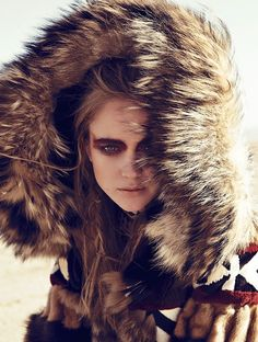 Rosie Tupper Wearing fur coats to heavy knitwear looks poses in Madame Figaro Spain magazine January issue