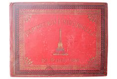 """Exposition Universelle de Paris, 1889 - Described by The Montecito Coll.  Exposition Universelle de Paris 1889, a souvenir of the Paris Exposition; red & gold. Presented by the NY Underwriters Agency, 1889. Phototype Berthoud Frères,. Hardcover; 10 plates of Exposition highlights including the Eiffel Tower. 1st edition. 12 pgs. English descriptions written under plates. Era: Antique; 19th century.  Condition: Very Good; some wear. Size:10""""L x 13""""W x 0.75""""H. Reg. $450. Now $299. (3/1/13) OKL"""