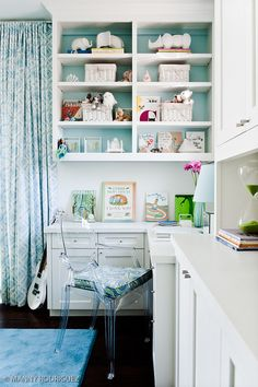 Pops of aqua on backs of bookshelf and in curtains. Sublime.