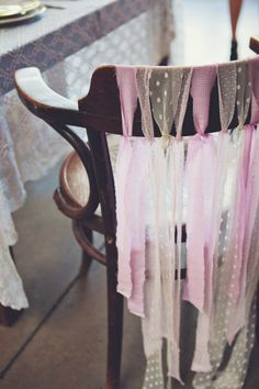 Thought they were ribbons; they're strips torn from fabric (maybe curtain sheers?). Less 'shabby chic' if cut rather than torn.