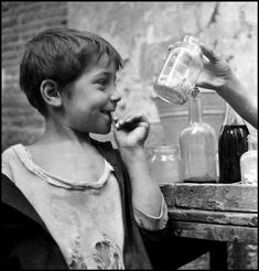 Italian Vintage Photographs ~ ~by David Seymour Naples, The temptation of candy to a ragged urchin, one of thousands filling the dirty, narrow streets of Naples. Henri Cartier Bresson, Magnum Photos, Old Pictures, Old Photos, Vintage Photographs, Vintage Photos, Vintage Italy, The Good Old Days, Cool Eyes