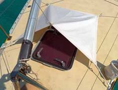 An efficient wind scoop will help ventilate a boat in hot climates. This design is neater and more durable than conventional wind scoops.