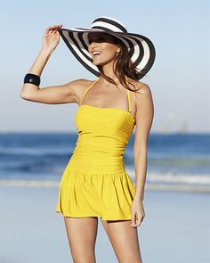love the big floppy hat with the swimdress