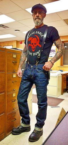 Edwin denim jeans, 1970's steel toe work boots, USA leather suspenders, Steve Earle concert shirt, chain wallet, cheap ebay cap.
