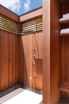 10 Excellent Examples Of Outdoor Shower Designs // This wood surrounded outdoor shower, designed by Mockler Taylor Architects, has some privacy and storage for towels.