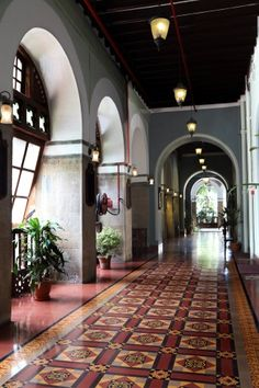A custom designed Heritage™ carpet welcomes visitors to the Royal Bombay Yacht Club. Winner of the UNESCO Cultural Heritage Conservation Award for Architect Vikas Dilawari Village House Design, Village Houses, Ceiling Decor, Ceiling Design, Floor Design, Tile Design, Tiled Hallway, Yacht Interior, Interior Design