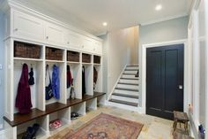Glamorous cubbies in Entry Contemporary with Garage Mudroom next to Basement Hockey Rink alongside Therma-tru Fiberglass Front Door and Entry Bench Mudroom Cubbies, Garage Lockers, Garage Bench, Garage Entry, Diy Garage, Front Entry, Entry Bench, Small Hallways, Stone Flooring