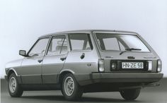 Fiat 131 Mirafiori 1300 Panorama (or in other words, estate car). Huge chunks of plastic, a plastic petrol cap with no locking cover, and just look at those huge reversing and rear fog lamps either side of the number plate
