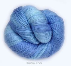 Blue Glass • Buttery soft and smooth • Amazing drape • Silky shimmer • Lustrous shine • Strong and durable  • 50% Merino Wool/50% Silk • 4 Ply Fingering/Sock Weight Yarn • 438 yds/400 m • 3.5 oz/100 gr • Recommended Needle: US 1-3 (2.5-3.25 mm) • Recommended Hook: US B1-E4 (2.25-3.5 mm) • Care: Hand wash in cool water, lay flat to dry.
