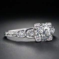 1.06 carat European-cut diamond; vintage engagement ring with beautifully intricate metalwork on platinum band!!!!!!!!  <3