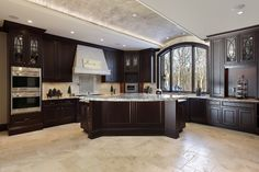 cabinets-tile-Large-kitchen-in-luxury-home. Classic Luxury Kitchen with Dark Wood ...