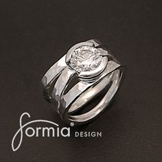 Custom ring we made for recently... Hammered silver ring with client's own diamond in half bezel platinum setting... Do you have a gemstone that wants a new ring? Contact us! http://www.formiadesign.com/custom-design-price-request/