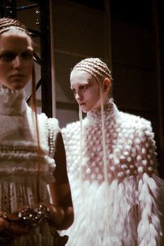 A beehive of cornrows and a progressive fur dress at Alexander McQueen AW14 PFW. Shot by Lea Colombo. More images here: http://www.dazeddigital.com/fashion/article/19120/1/alexander-mcqueen-aw14