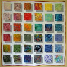"""Batik Shadow Quilt"" by ""TRJcraft"" based on the one by ""Elena""   See how the slight differences in color matter (also possible that differences are more from their lighting  photography -- color is tricky to choose and to depict.)"