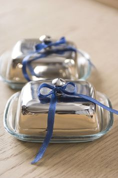 Pretty and small, covered silver servers embellished with a blue bow, found at @ Kaille As In Kyle on Pinterest