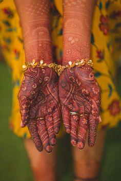 Mehendi Designs - Intricate Mehendi Bridal Design with Gold Floral Bracelet | WedMeGood #wedmegood #indianbride #mehendidesign #mehandi #bridalmehendi #handmehendi #henna #tattoo