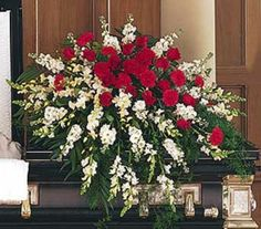 Order funeral flowers and send sympathy flowers including casket sprays, easel arrangements, plants, and sympathy arrangements. Casket Flowers, Grave Flowers, Cemetery Flowers, Funeral Flowers, Silk Flowers, White Flowers, White Roses, Red Roses, Funeral Floral Arrangements