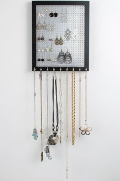 Organize your Hook Earrings & NecklacesI've created the BEST 2-n-1 Jewelry Organizer. This 8x10 Solid Black Frame holds all your Hook Earrings & Necklaces. It hangs on the wall to provide the perfect display to showcase all your Jewelry and Necklaces. The beautiful hanging wall frame has a metal screen in the middle with an elegant design to hook your earrings into and it has 9 hooks along the bottom to hang all of your necklaces. It also comes in a White frame, please see other listi...