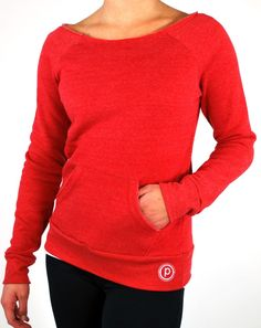 Comfy sweatshirt with raw-edge cut neckline. Hangs slightly off the shoulder for a relaxed, vintage-inspired fit. Circle P on hip, Pure Barre on neck