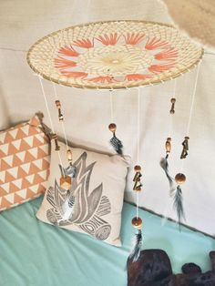 "Feather ""Dream Catcher""-inspired mobile in this Boho Camp-Themed Nursery"