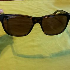 NWOT Authentic Ray Ban RB4181 NWOT Great go to glasses! Polarized! Tortoise frame with brown lenses. Never worn. Perfect condition!  Bought at Sunglass Hut. Comes with Ray Ban case and microfiber cloth! Ray-Ban Accessories Sunglasses