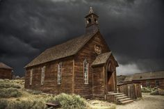 Not an old farmhouse - but I love this picture. A little wooden church set against a very dark foreboding sky.