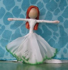 This little leprechaun fairy is wearing a dress made of white carnation petals tinged with green All of my flower fairies are handmade