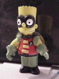 "This is a Bart ""Robin"" figure I made from a Bart Simpson action figure and some sculpy clay"
