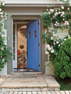 Happy #PorchPictureThursday! This pretty periwinkle front door from Meridy W. King Interiors simply radiates welcome.