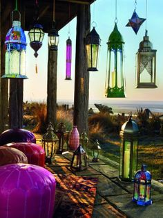 Very fun relaxed bohemian #Moroccan terrace #design with a view. It's all about the Moroccan lanterns and poufs.