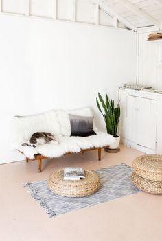 Minimalist boho: white, simple, bamboo stools / A well traveled woman...