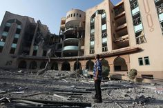 August 4, 2014    A Palestinian man observes the damage at the Islamic University of Gaza on August 2, after it was hit in an overnight Israeli strike.   One-fourth of Gaza's population displaced by Israel's violence   The Electronic Intifada