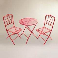 Finished in vibrant red, our metal bistro set brings an iconic look and a pop of color to your garden or patio. This fully assembled set features a table and two chairs that fold for easy, compact storage.