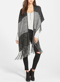 Ponchos for fall are a must. Simply throw them over a top and skinny jeans for an effortless, yet still so chic, autumn ensemble.