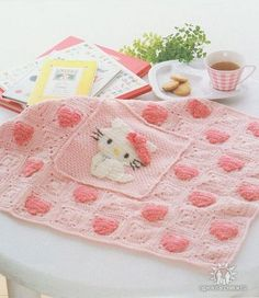 Hello Kitty blanket ♥LCB♥ with diagram for Kitty. The blanket is made of 7 granny height x 9 granny width. Every other granny is Kitty's face on the granny. Simple work.