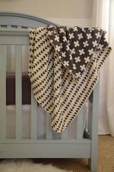 """my two best selling prints in one dreamy blanket. one side is my plus three in charcoal print and the other side is my flying triangle print. made with the softest organic cotton knit, this dual-layered blanket is perfect for cuddling with on cool nights.    the blanket is a generously sized 36""""x..."""