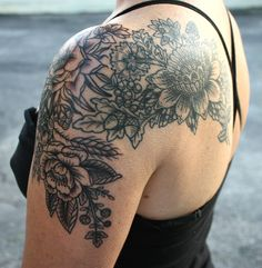 I like something like this, but more on the back incorporating my bird thats already there and just a little peak through over the top of the shoulder.