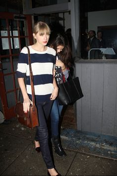 Taylor Swift's Striped sweater, jeans and brown messenger bag – With Selena Gomez.  Outfit details: http://wwtaylorw.com/2252/
