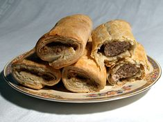 A Sausage Roll is a savoury pastry.    It is made from skinless sausage meat, rolled in a cylinder, covered with puff pastry and then baked. http://www.cooksinfo.com/sausage-rolls
