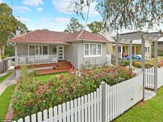 A young Sydney couple increased the value of their Thornleigh home by more than a million dollars in just two years by renovating the entire property and adding an extra bedroom. Red Roof House, Facade House, House Exteriors, House Paint Exterior, Exterior House Colors, Exterior Design, Weatherboard Exterior, Home Exterior Makeover, Beach Cottage Decor