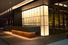 Reception desk, under light, back lit onyx, bronze frame, heavy stone top,