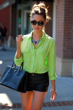 Pop of Lime with cute black shorts, blue baubles and oversized Prada bag!