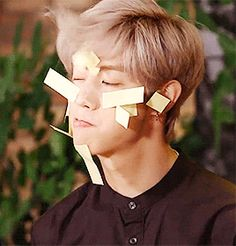 Mark of GOT7 blowing away those darn sticky notes