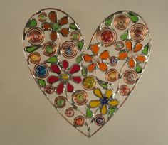 Heart with muticolored flowers