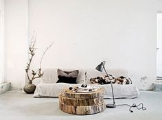 9 clever coffee table alternatives for small spaces. Stylish upgrades to your living room staple like mismatched side tables, lucite chest or cushioned stool with tray. For more living room furniture ideas and home decor alternatives go to Domino. Tree Trunk Coffee Table, Tree Stump Table, Trunk Table, Tree Stumps, Coffee Tables, Coffee Table Alternatives, Wooden Trunks, Table Cafe, Deco Nature