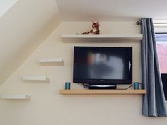 Cat shelves DIY - There's no tutorial, but as you see these are floating shelves.