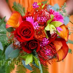 Calla lillies, roses mixed with other flowers and greenery to make a beautiful yet  simple bouquet!