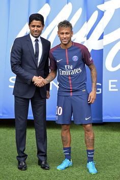 Neymar poses with his new jersey next to Paris Saint-Germain President Nasser Al-Khelaifi after a press conference on August 4, 2017 in Paris, France. Neymar signed a 5 year contract for 222 Million Euro.